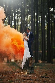 forest wedding with orange smoke bomb