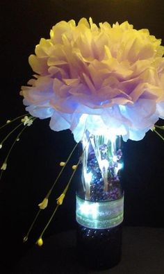 Simply radiant events centerpiece and cupcake tower www purple centerpiece made of tissue paper flower with lights by ari lib flowers mightylinksfo