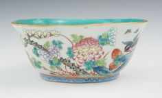 "A Chinese Famille Rose Phoenix Wedding Bowl With a Tongzhi (ca. 1862-1874) mark on the underside in Zhanuscript in iron red surrounded by turquoise glaze, the tri-corner porcelain bowl has a 1/4""H foot, undulating sides, . 5-5/8""W x 2-3/8""H, the interior glazed in turquoise, the exterior beautifully enameled with birds, butterflies and flowers, blue geometric design around the foot."