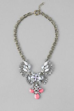 "Seize the day with the Perry St. Statement Necklace! Medallions of shimmering crystals with soft pink hues accented with a pop of neon makes this sensational statement piece a must have for you collection!<br /> - 16"" length<br /> - 1.25"" extension<br /> - Lead & nickel free<br /> - Imported"