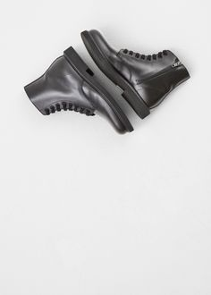 Woman by Common Projects Lace-up Combat Boot in Black #totokaelo #boots #commonprojects