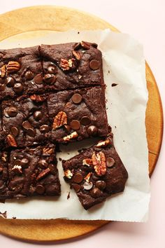 30-minute, 10 ingredient vegan gluten free brownies that are naturally sweetened, fudgy, and studded with chocolate chips and nuts!