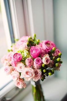 Roses, ranunculus, hypericum, hydrangea.