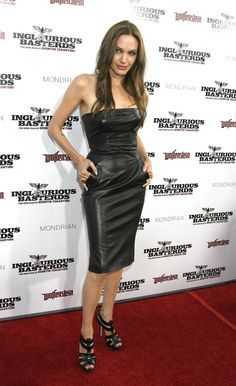 Pin for Later: How Vampy Did Angelina Jolie Go For Her Wedding? Angelina Jolie's Red Carpet Transformation Angelina turned heads at the LA premiere of Inglourious Basterds in a black, strapless, leather minidress designed by Michael Kors in 2009.