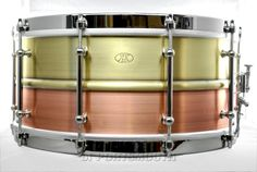 AK Drums 2 Piece Brass/Copper Snare Drum 6.5x14 Hear how it sounds! http://youtu.be/0zE9qzRAge0 Available for purchase here! http://www.drumcenternh.com/drums/snare-drums/ak-drums-2-piece-brass-copper-snare-drum-6-5x14.html