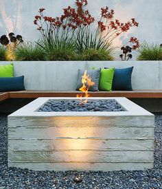 A cantilevered ipe bench hugs a custom board-formed concrete fire pit. Photo 3 of 7 in Outdoor Fireplaces and Fire Pits We Love by Zachary Edelson from A Craftsman-Style Bungalow is Turned Inside Out Fire Pit Table, Diy Fire Pit, Fire Pit Backyard, Backyard Camping, Backyard Seating, Outdoor Gas Fire Pit, Gas Fire Pits, Diy Propane Fire Pit, Cozy Backyard