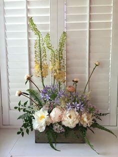 Spring vegetative design with peonies, eremerus, agapanthus and allium.