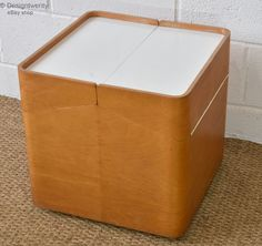The storage unit is beechwood faced with white laminate hinged top. It is in very good condition for its age, showing some light marks around the unit as expected for its age. It has been cleaned and wax polished.   eBay!
