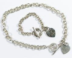 Lot 529: Tiffany and Co Sterling Silver Toggle Jewelry Set; Including necklace and bracelet, both having  heart charms; marked on charms