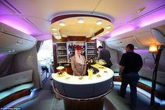 Fancy a drink? These airlines are offering some of the best bar service in the skies. Pictured: The Emirates Airbus A380 in-flight bar and lounge