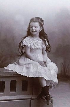 Antique photo of pretty girl in beautiful dress circa 1910.
