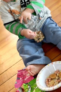 Young toddlers and even older babies can make their own sensory bottle to play with. Its all edible so completely safe for young ones to make themselves!