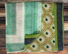 Recycled sari throw - give a gift that matters. This blanket gives a woman in India critical income to care for her family and rise from poverty! Recycled sari blankets are sometimes called a 'vintage kantha' blanket. $79