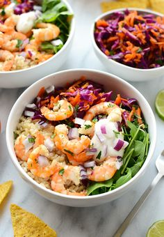 Eat the rainbow with these delicious Cilantro Lime Shrimp Bowls made with fresh shrimp, brown rice, cabbage slaw, and a homemade Greek yogurt dressing!