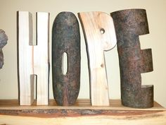 "7"" tall HOPE word, letters carved from silver maple log 