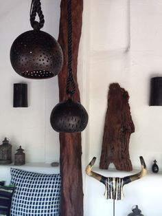 Beautiful baked clay stylish globe lanterns made in Nicaragua available through Tribal Hotel.