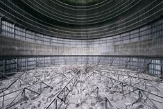 This is the view inside a gasometer - a structure that resembles the look and feel of a cooling tower - an industrial recipient used for the storage of natural gas in Belgium Cooling Tower, Sci Fi Films, Tours, Travel News, Beautiful Images, Abandoned, The Good Place, Europe, Construction