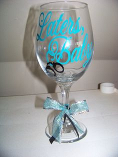 Laters, Baby - 50 Shades of Grey Wine Glass Turquoise With Black Handcuffs. $12.00, via Etsy.