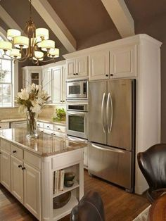 Taupe and white kitchen with a great slanted ceiling.