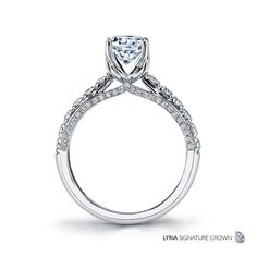 New Classic Bridal R3730 Ribbons of sparkling white diamonds on the profile add style and charm to this classic diamond engagement ring finished with the LYRIA Signature Crown.