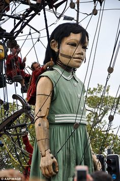She's one of manyLittle Girl Giant, one of many marionettes created and operated by Frenc...