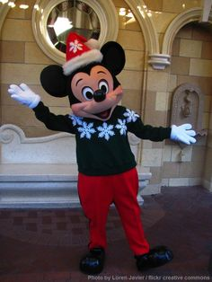 Mickey Mouse in his Christmas sweater.   Disneyland.