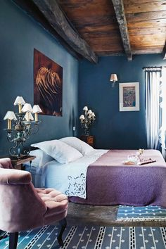 Purple textiles and blue walls in the Joséphine bedroom at La Singulière hotel, Aveyron, France