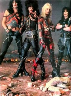 Motely Crue was a little more in the vein during their glam years, but people still forget how much more feminine their early years were. L to R: Nikki Sixx (bass), Tommy Lee (drums), Vince Neil (lead vocals), Mick Mars (lead guitar). 80s Hair Metal, Hair Metal Bands, 80s Hair Bands, Nikki Sixx, Girls Girls Girls, Glam Metal, Rock Band Posters, El Rock And Roll, Shout At The Devil