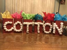 2nd wedding anniversary: Cotton!  Letter C: Candy, O: Oreos, T: Towels (kitchen), T: Tickets (lotto scratch offs), O: Ornament, N: Nuts