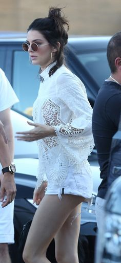 Kendall Jenner wearing a white crochet top and white denim shorts