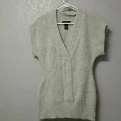 Tunic length sweater Light heather grey, deep V-neck sweater. Nylon, Angora and Lambswool blend. Machine washable or dry clean. Very soft and cozy. Excellent used condition. Elena Solano Sweaters V-Necks