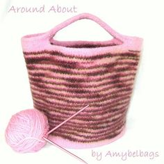 "Cute round bag knitted in the round. ""Easy"" pattern (from knitting in my backyard blog)."