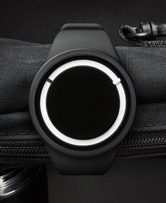 Eclipse Watch by ZIIIRO - Using a patented Swiss Super-LumiNova pigment on its watch dial and minute hand, the Eclipse watch offers day and night visibility with bright illumination in the dark. Read more at http://www.yankodesign.com/2014/01/08/total-eclipse-of-the-wrist/#f4JTvLlYhUI2v8lG.99