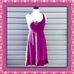 """Boutique NWOT Tunic Dress Raspberry Size Medium Boutique NWOT Tunic Dress Raspberry Color Size Medium. Materials: 47% Cotton, 47% Modal, 6% Spandex. Contrast is 100% Rayon. Machine Wash Cold Delicate Cycle. Measurements laying flat: 14.5"""", Length 35"""". Can be worn as a Tunic with leggings or a Dress. Mannequin is a 36-24-36 to give you an idea of fit. No Trades, PayPal or LowBall Offers Boutique Dresses"""