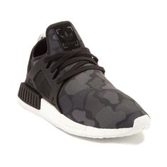 Sporting a progressive design with minimalist features, the new NMD XR1 from adidas has you covered. The NMD XR1 Athletic Shoe combines modern style with athletic performance for a sleek trainer that's primed for everyday wear, featuring a camouflage printed, Primeknit upper with Boost midsole for energized stepping, and lightweight rubber tread outsole for premium traction and flexibility.