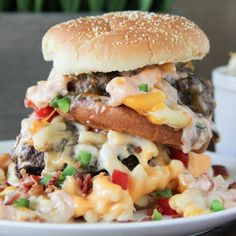 Outrageous Mac and Cheeseburger. Blend of beef short rib brisket and chuck topped with gooey mac & cheese and all the fixins take this cheeseburger right off the cliff! Mac And Cheese Burger, Burger And Fries, Macaroni And Cheese, Mac Cheese, Milk Recipes, Burger Recipes, Beef Recipes, Burger Ideas, Burger Mania