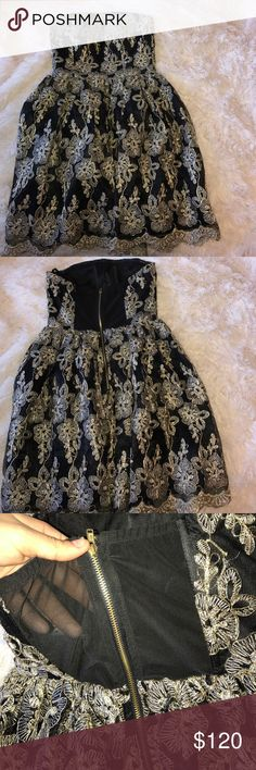 black strapless dress with gold embroidery I love this dress, has amazing detail! never been worn, just tried on, comes with tags. typically I'm not a big fan of strapless because they fall down but this dress fits perfect and has a gel lining to keep up. Deb Dresses