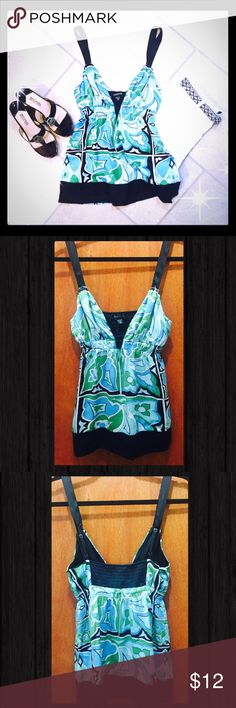 Turquoise and black bebe top  So GORGEOUS and absolutely PERFECT for summer ⛱ Turquoise blue and green print camisole with black adjustable ribbon straps.  Can be dressed up with heels and dress pants or dressed down with a pair of denim cut offs and wedges  Really...the possibilities are endless!! In Gently worn condition ☮ bebe Tops Camisoles