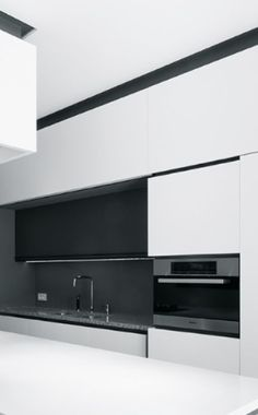 Super contemporary black and white flat surface kitchen