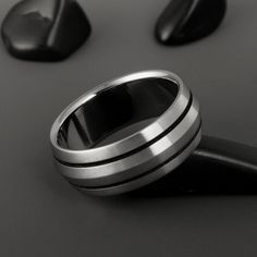 Titanium Wedding Band - Peaked Profile - Two Black Pinstripes on Either Side. $139.00, via Etsy.