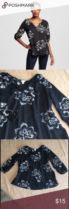 Floral print peasant blouse Floral print black & white peasant blouse. New condition without tags. Has been tried on & washed but never worn. Runs large in my opinion.  measurement from armpit to armpit is approx 25 in.  Length from top of shoulder to bottom edge is approx. 27 in.  nonsmoking home.  Merona Tops