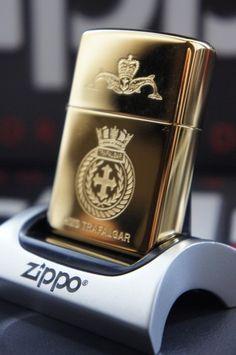 ZIPPO LIGHTER GOLD PLATED GENUINE MILITARY HMS TRAFALGAR WITH DOLPHIN CREST  RARE & UNUSUAL ZIPPO LIGHTERS, CASES, AND ACCESSORIES  From easyonthewedge2011
