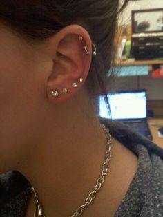 Left ear piercings (love the four bottom ones)