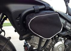 For sale is one pair of crash bar bags. The bags fit GIVI brand crash bars P/N TN532 SUZUKI for a 2004-2011 V-STROM DL650. Custom made to securely mount to the crash bars using reinforced velcro straps. The bags are made from heavy duty (1000 denier) Nylon Cordura fabric, urethane coated & water resistant. They feature strong attachment points, a very high quality weatherproof zipper (#10 coil, made in USA) & highly visible reflective trim. NOTE - I dont claim these bags are 10...