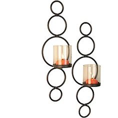 @Overstock - Add a modern touch to your home with these stylish candle sconces. Made from iron for added durability, these wall-mountable candle sconces hold one votive candle each, and feature a stunning circular design that gives them a contemporary flair.http://www.overstock.com/Home-Garden/Circles-Candle-Sconce-Set-of-2/4490720/product.html?CID=214117 $28.49