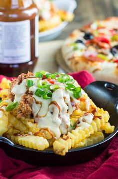 Southern Cheese Fries with pulled pork, BBQ sauce, and pimiento cheese sauce.