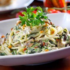 PASTA PRIMAVERA recipe from Sirio Maccioni of the world renowned Le Cirque Restaurant.  Spaghetti with mushrooms, asparagus, broccoli, peas and pine nuts in a creamy sauce with basil.