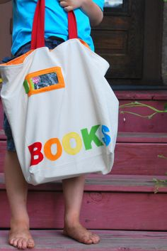 Library book bag tutorial- with free pattern!  (Includes a little pocket on the front to store your library card!)