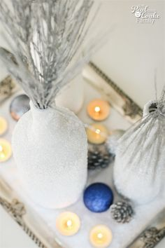 Gorgeous DIY winter Centerpiece made from wine bottles and epsom salt. This will be perfect in my home decor! Wine Bottle Crafts, Wine Bottles, Homemade Crafts, Diy Crafts, Winter Centerpieces, Winter Home Decor, Epsom Salt, Winter Fun, Easy Diy