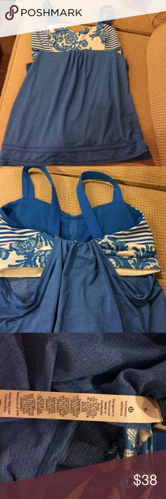 Lululemon tank top size 8 Lululemon tank top size 8.  Beautiful blue tank with built in shelf bra with cinch waist.  Excellent like new condition.  Bright fun color. lululemon athletica Tops Tank Tops